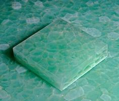 Recycled green glass tiles for bathroom floor... Gorgeous and ecofriendly!!! I love these!