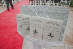 Chandelier themed programs on a lace display | villasiena.cc