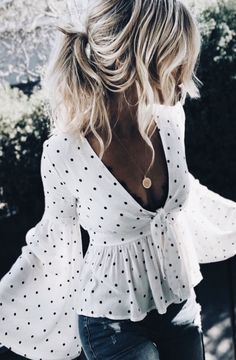 Super sexy top, but I could do without the polka dots. LOVE the style, though.