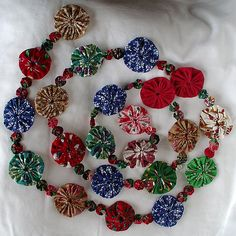 Christmas garland | Christmas garland made from fabric yo-yo's, Great way to use up small fabric scraps.