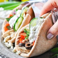 Loaded with plenty of fresh herbs, garlic, and Mediterranean flavor, these Slow Cooker Greek Chicken Gyros are a healthy 10-minute dinner foryour busiest days! Slow Cooker Greek Chicken Gyros! Healthy Recipes | Healthy Dinner Recipes | Crock Pot Recipes | Chicken Recipes | Easy Dinner Recipes | Crock Pot Meals | Crock Pot Chicken