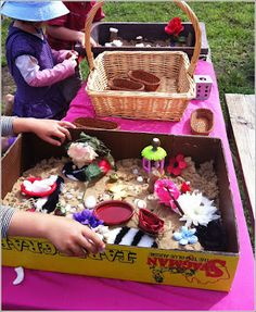 "Worlds of Imagination in a Sand Tray -  Let the Children Play    ""Scraps of material, small dishes, fake flowers, pebbles, driftwood pieces, shells and plastic butterflies were arranged and rearranged endlessly to create worlds and fairy gardens."""