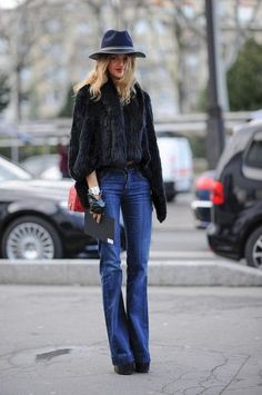 A wide-brimmed hat and a fur take wide-legged denim from basic to boho