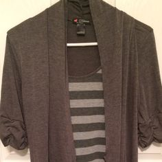 Delirious Grey Tunic Gently used and super cute grey tunic! It pairs wonderfully with leggings and boots! :) Tops Tunics