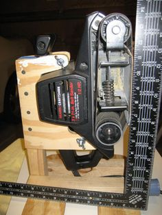 homemade tools Belt Sander Stand: Make a stand for your belt sander and free a hand!My wonderful wife bought me a boatload of Sears Craftsman power tools a few years ago. Woodworking Ideas To Sell, Woodworking Organization, Woodworking Basics, Beginner Woodworking Projects, Woodworking Joints, Woodworking Patterns, Woodworking Techniques, Woodworking Lamp, Woodworking Garage