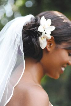 veil above low bun with flowers