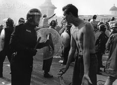 Anti poll tax demonstrators confront the police in Trafalgar square during the anti poll tax riots of April 1990