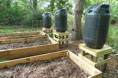 Cool article on making very simple rain barrels for the garden - I like the layout of the barrels and the garden beds