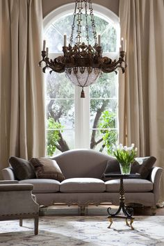 Living room with neutral palette, chandelier as focal point, gorgeous palladium windows~