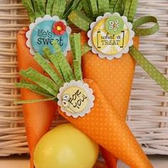 Easter Bunny Carrots {DIY Ideas}  These cute paper carrots can be made any size and are a great party favor to send your Easter guests home with at the end of the day.  You could even add the guest names and  hang them off the seat backs with ribbon and they can multi-task as a decoration and place card.