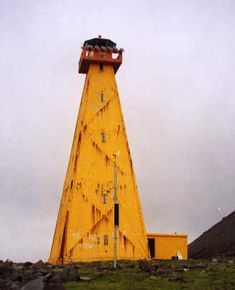 Straumnes Northwest Lighthouse~1919~locatedat the tip of a peninsula marking the northwest corner of Iceland.  It is one of two Straumnes lighthouses in northern Iceland.  It is accessible only by boat.~Iceland