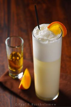 Ramos Gin Fizz - A pre-prohibition cocktail! Gin, lemon, lime, egg white, orange flower water, cream & seltzer. Yum!
