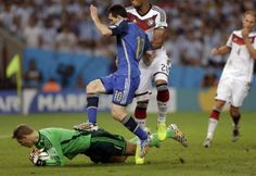 Germany's goalkeeper Manuel Neuer, bottom, makes a save as Argentina's Lionel Messi jumps over during the World Cup final soccer match between Germany and Argentina at the Maracana Stadium in Rio de Janeiro, Brazil, Sunday, July 13, 2014.