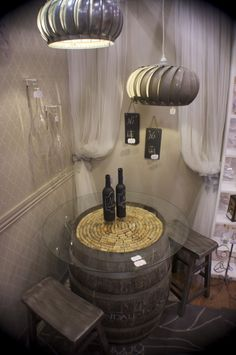 rustic elegance, this old wine barrel was turned into a wine table
