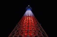 TOKYO, JAPAN - NOVEMBER 15: The Tokyo Skytree illuminated in the color of the French flag on November 15, 2015 in Tokyo, Japan. At least 128 people were killed in a series of bombings and shootings across Paris, including at a soccer game at the Stade de France and a concert at the Bataclan theater. (Photo by Takashi Aoyama/Getty Images)