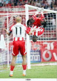 ΟΛΥΜΠΙΑΚΟΣ - Pesetero.Net Red Database: Tresor Lomana Lua Lua (DR Congo, 2007-2008, 2010) Congo, Football Players, Gate, Passion, Island, Sunset, Sports, Red, Moon Moon