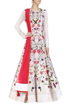 Samant Chauhan  off white flared kalidaar gown in cotton silk base with multicolor floral thread and zari embroidery on the front and back. It has hook and eye closure placket on front and churidaar sleeves. It comes along with red net dupatta with tassel hangings at corners.
