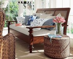 Wonderful wicker and blue n white throw pillows.