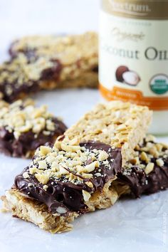 Chewy no-bake cashew granola bars, dipped in chocolate! Made with coconut oil and no refined sugar!