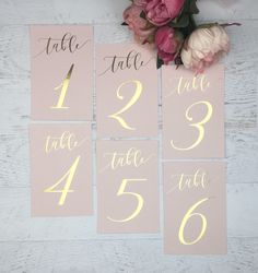Blush Table Numbers - Wedding Table Numbers - Pink Table Numbers - Gold Table Decor - Pink Table Markers - Gold Foil Table Numbers - Blush by GildedPaperCo on Etsy https://www.etsy.com/listing/538464343/blush-table-numbers-wedding-table
