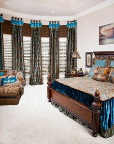 Elegant Bedroom and Warm Exterior - Blue, turquoise and brown fabrics and pillows tied together with classical wooden bed framing. - Brandi Renee Designs, LLC - www.brandireneedesigns.com
