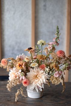 This late autumn centerpiece featured blooms in cream, soft yellow, and peach, including dahlias, zi Fall Wedding Centerpieces, Fall Wedding Flowers, Fall Flowers, Fresh Flowers, Dried Flowers, Floral Wedding, Beautiful Flowers, September Wedding Flowers, Wedding Yellow