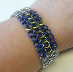 'pattern on this bracelet is 4-1 European and Swedish flag is folded in the middle.' by tezzandesign. #bracelets #jewellery #sweden #chainmaille #blueandyellow