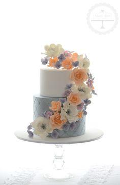 Textured wedding cake with sugar flowers