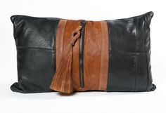 A unique handmade lumbar pillow from TEXA, constructed from re-purposed vintage leather outerwear and detailed with a single horsehair tassel zipper pull. Please note the vintage condition of the repurposed leather, light wear to edges and seams. From the Cavalier Collection by Jay Jeffers.