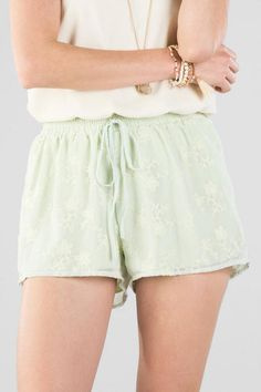 """The Loralinda Embroidered Shorts are short & sweet! Tiny embroidered flowers decorate these soft leaf colored shorts.<br /> <br /> - 11"""" length<br /> - 25"""" waist<br /> - 2"""" inseam<br /> - measured from a size small<br /> <br /> - 100% Polyester<br /> - Machine Wash<br /> - Imported"""