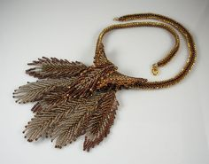 Inspiration... I LOVE this! The beaded feathers look fairly simple to assemble, must try something similar. The color variations are lovely.