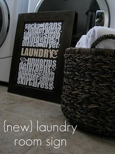 Loving this laundry room sign made from an old cabinet door!