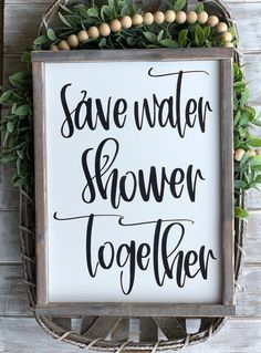 "This listing is for a ""save water shower together"" handmade sign. The frame is stained and the sign is a white background with black lettering. This sign measur"