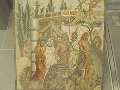 Sacrificio de Ifixénia en Áulide.    Museo de Empúries. Mosaico que decoraba o pavimento dunha sala principal dunha casa áinda non excavada na cidade romana (s. I.a.C.)