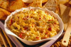 Warm up some bellies with a delectable Hot Cheesy Crab Dip. You'll need to dice up some peppers, chop those chilies, add fresh crab meat, and sprinkle on Sargento Chef Blends Shredded 4 Cheese Pizzeria. Better have a backup bowl ready. This dip goes fast!