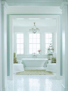 Week 4:Tubs & Showers: Simple yet elegant, i love the shape of the tub and the simple chandelier above. this tub room, really gives off a calm tranquil feeling.  Source:  http://www.bhg.com/bathroom/shower-bath/design-ideas1/#page=12