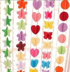 cortina de cartulina plegada en forma de estrellas-flores-corazon-mariposa-circulo