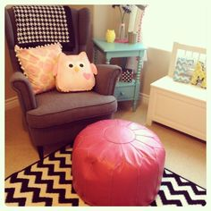 Adore this chair + ottoman pouf in this sweet nursery!