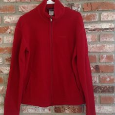 Patagonia dark red Synchilla zip up size women L Great condition. No rips or tears. Dark red Patagonia women's Synchilla full zip. Size women's large Patagonia Jackets & Coats