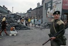 Corporal of the Queen's Regiment in Belfast, Northern Ireland during disorders in September 1969. In the background are local people. (AP Photo/Royle) Ref #: PA.11408246 Date: 14/09/1969