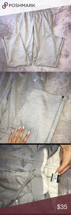 """Grey Nike Sweats I believe these are men's sweats but I purchased for myself and they worked perfectly. They are a heather light grey with a fleece material on the inside all throughout, with an elastic band, tie at the waist, with pockets and zippers on the bottom on the sweats. They are a """"Thera-Fit"""" style and size Small. In perfect condition never worn. Nike Pants Track Pants & Joggers"""