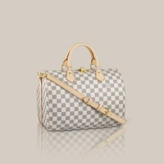 Speedy Bandoulière 30  Damier Azur Canvas Every feature of this Speedy is iconic: the unique shape, the leather handles, the Damier Azur can...
