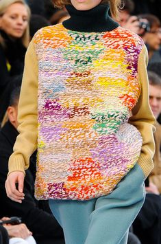 Inspiration - Chloe F/W 2012... very interesting using the back of stst and a random colourworked design....could use marled yarn or 1 strand cream and 1 strand bright...sleeves are solid and turtleneck black..the back has black zipper showing