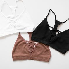 A simple bralette with the criss cross strappy detailing in front and a racerback. Wear it underneath loose-fitting shirts, or even as a yoga top. Made with lig