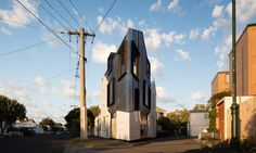 Acute House in Melbourne proves that even a tiny, oddly-shaped site can accommodate a balanced, harmonious residence.