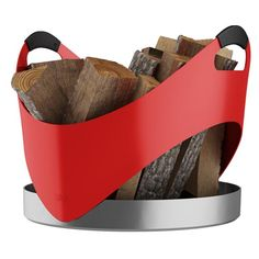 The Carry firewood basket by RAIS has comfortable and ergonomically designed silicone-coated handles, which make it easy to carry your firewood from your outdoor log store to your fireplace.  The basket is assembled by hand with a fixed bottom and a practical, high edge.  Diameter: 45 cm. Height: 45 cm.  Available in a selection of colours - white, warm red , lime green, powder blue and matt black.