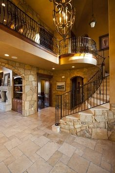 I am a huge fan of stone!! this screams my name! I would maybe add some dark wood on the stair steps though!