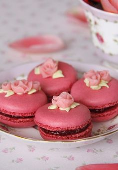 Raspberry Macaroons  Raspberry macaroons decorated with roses made from raspberry almond paste.