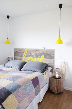 Love the weathered gray planks with the vibrant lemon yellow -- beautiful contrast!