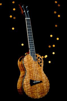 DeVine Guitars and Ukuleles : Guitar gallery : Ukulele gallery : Custom Koa Guitars and Kasha Ukuleles of Maui, Hawaii